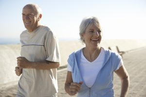older couple jogging together outside