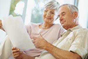 Happy senior couple planning for retirement